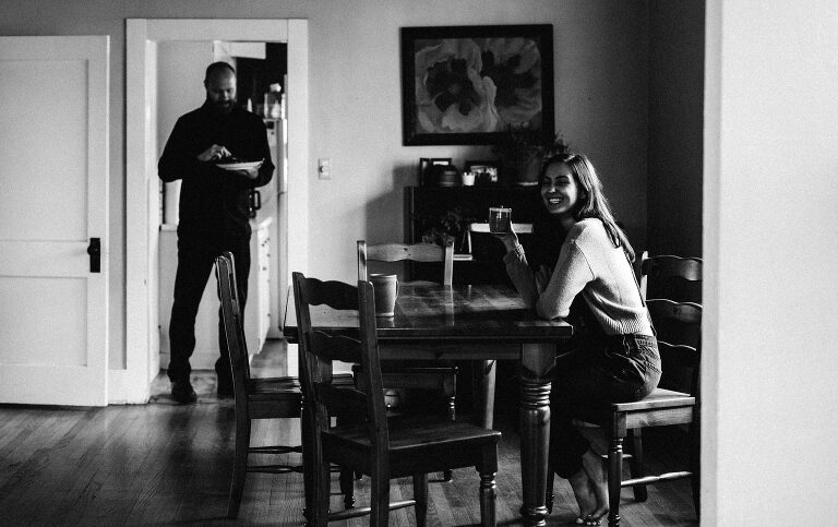 colorado documentary photographer - a couple in their home sharing breakfast